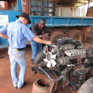 Marcellin talking through a vehicle rebuild with Water for Good founder Jim Hocking.